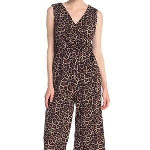 A sleeveless leopard printed cropped jumpsuit.  Fi
